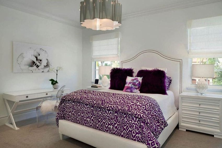 Eclectic white bedroom with drum pendant light and purple accent colors