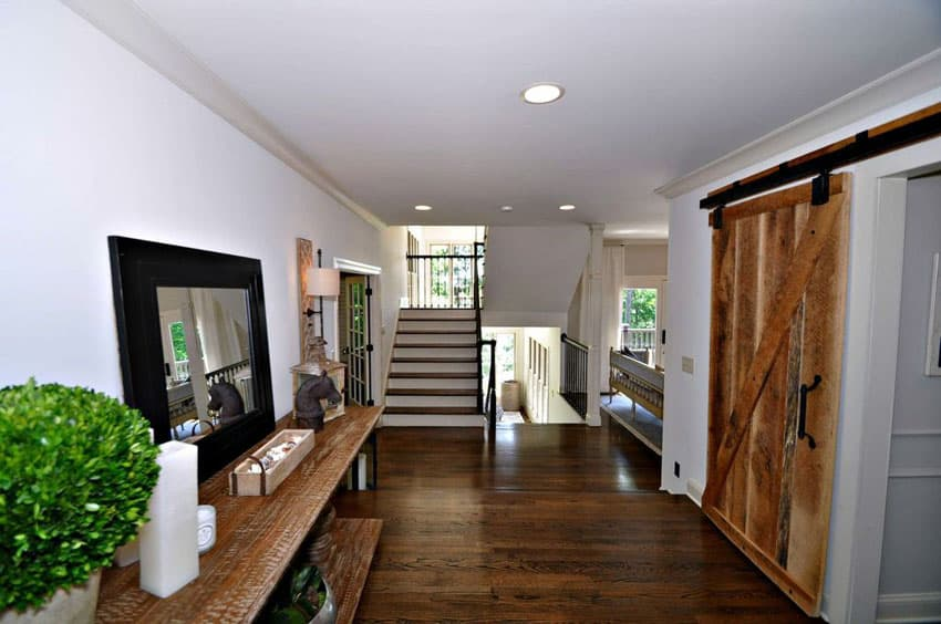 Home hallway with reclaimed wood sliding barn door