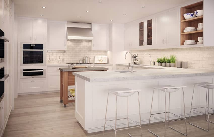 Modern White Kitchen With Marble Counter Peninsula And Portable Rolling Island