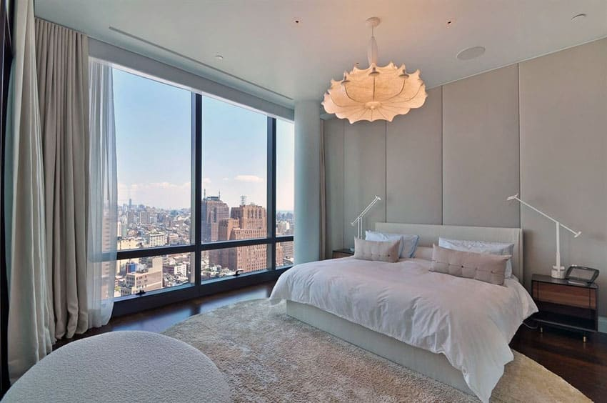 Penthouse apartment bedroom with contemporary chandelier