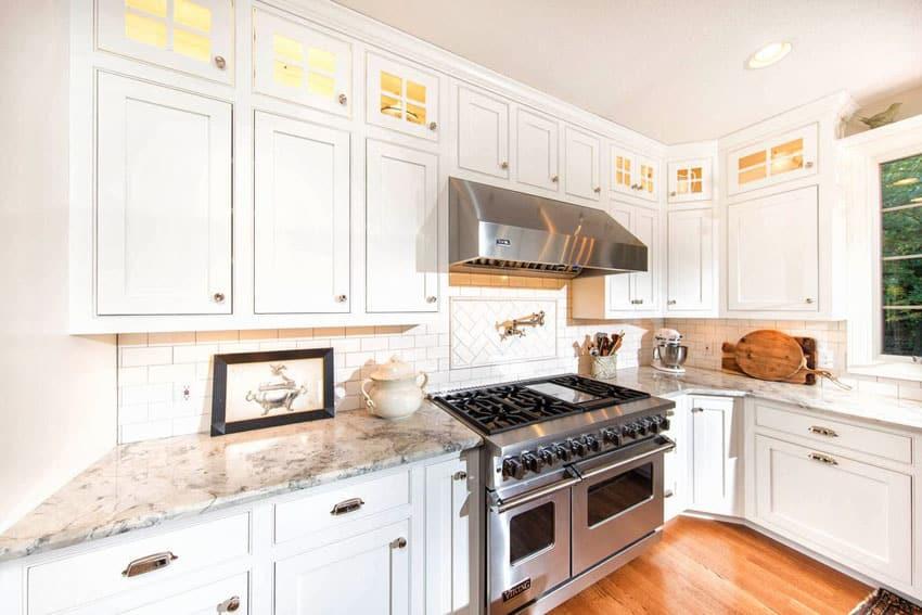 Traditional White Cabinet Kitchen With White Granite, Subway Tile Backsplash,  And Oak Engineered Hardwood