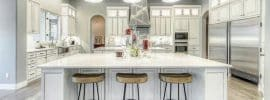 transitional-kitchen-with-white-cabinets-breakfast-bar-porcelain-tile-floors-and-industrial-dome-shape-pendant-lights