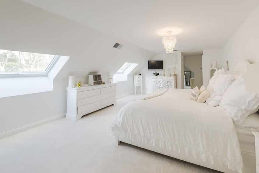 Upstairs attic bedroom with white color theme and drum chandelier