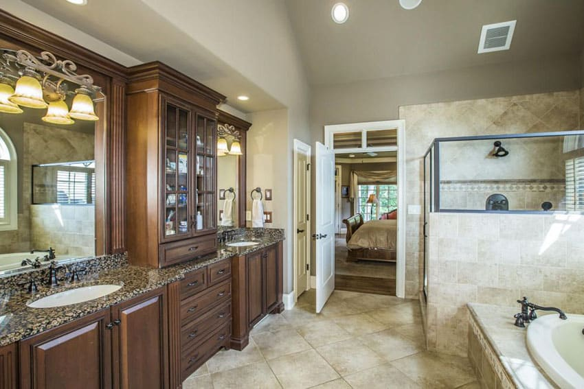 Beautiful bathroom with granite counter vanities and high ceilings