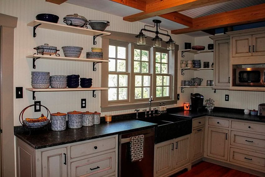 Country kitchen with black basin farmhouse sink, open shelving and rustic cabinetry