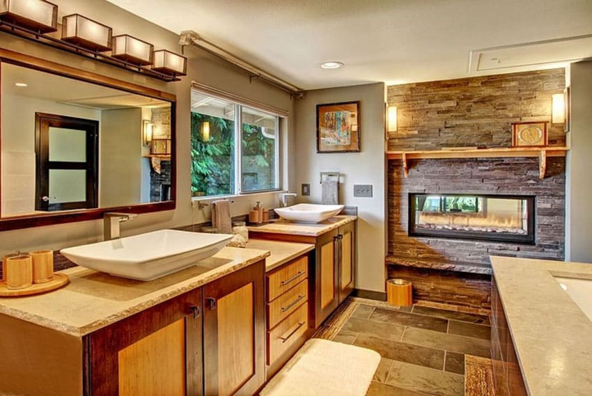 Craftsman master bathroom with stacked stone fireplace and vessel sinks