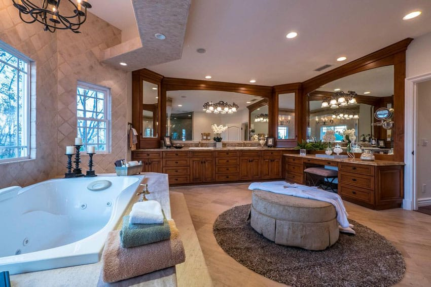 Craftsman master bathroom with whirlpool tub and granite topped vanity