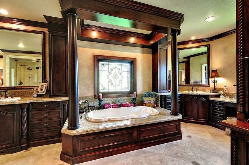 Craftsman master bathroom with wood pillar around enclosed bathroom and decorative wood vanities with dual sinks