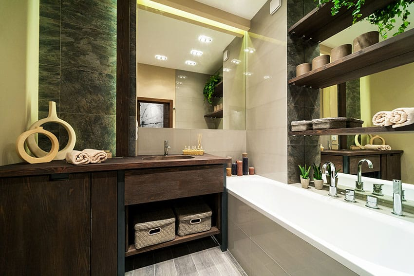 Eclectic bathroom with rustic wood vanity and shelving over bathtub