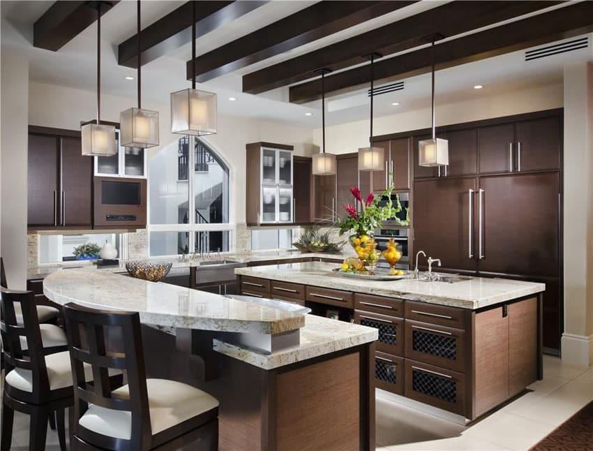Kitchen with dark high gloss foil cabinets, breakfast bar island, mini pendant lights and bianco romano granite counters
