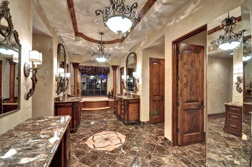 Luxury craftsman master bathroom with emperador dark marble counters