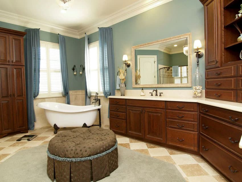Traditional bathroom with clawfoot tub and decorative wood vanity