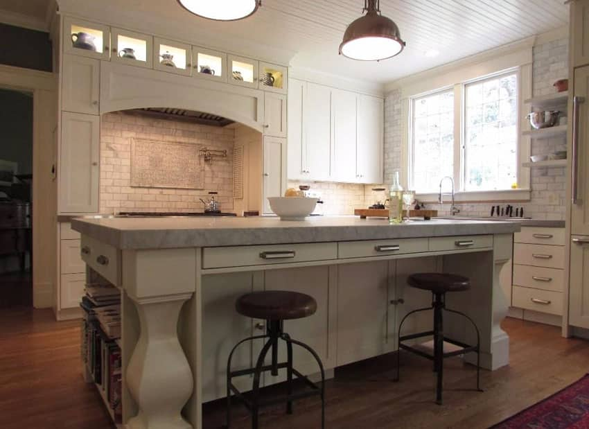 White country kitchen with breakfast bar island marble subway tile and bead board ceiling