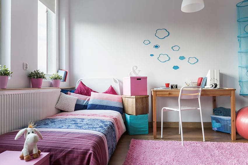 Cozy girls room with comfortable bed and small desk