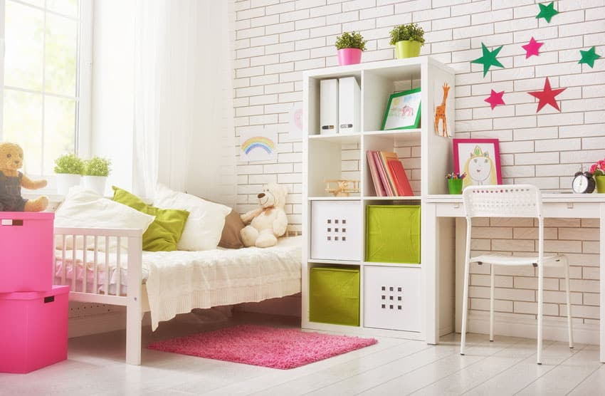 Girls arts and crafts bedroom with brick
