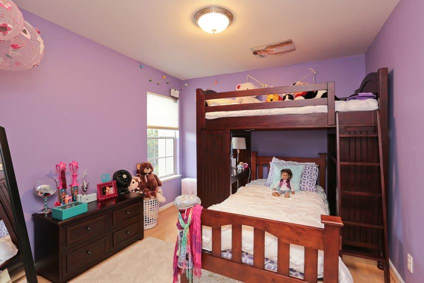 Girls bedroom with bunk bed purple walls