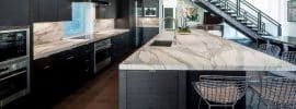 luxury-contemporary-kitchen-with-black-cabinets-marble-counter-island