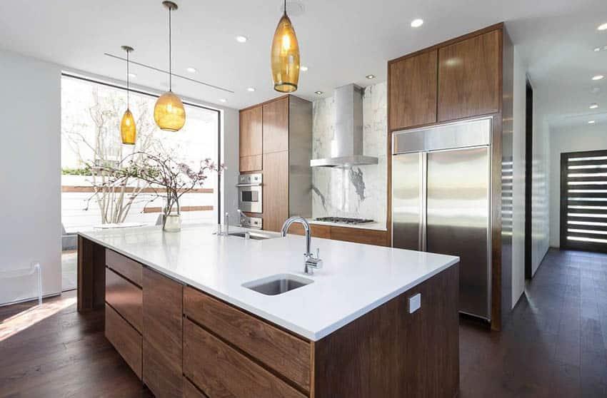 modern-kitchen-with-white-quartz-countertops-and-pendant-lights