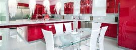 red-modern-kitchen-with-white-corian-countertop-and-feather-pendant-lights