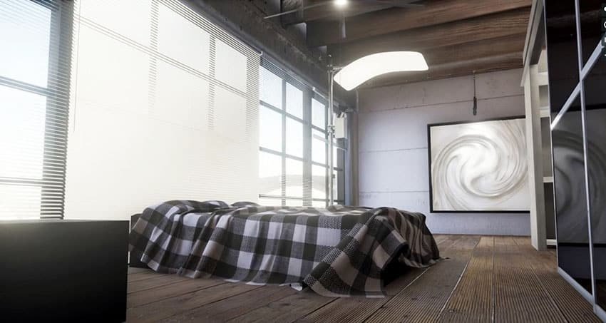 Loft bedroom with wide plank wood floors wall of windows