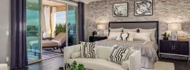 master-bedroom-with-hickory-hardwood-floors-and-stone-accent-wall