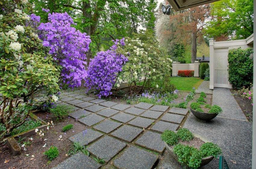 Aggregate cement paver path in backyard garden