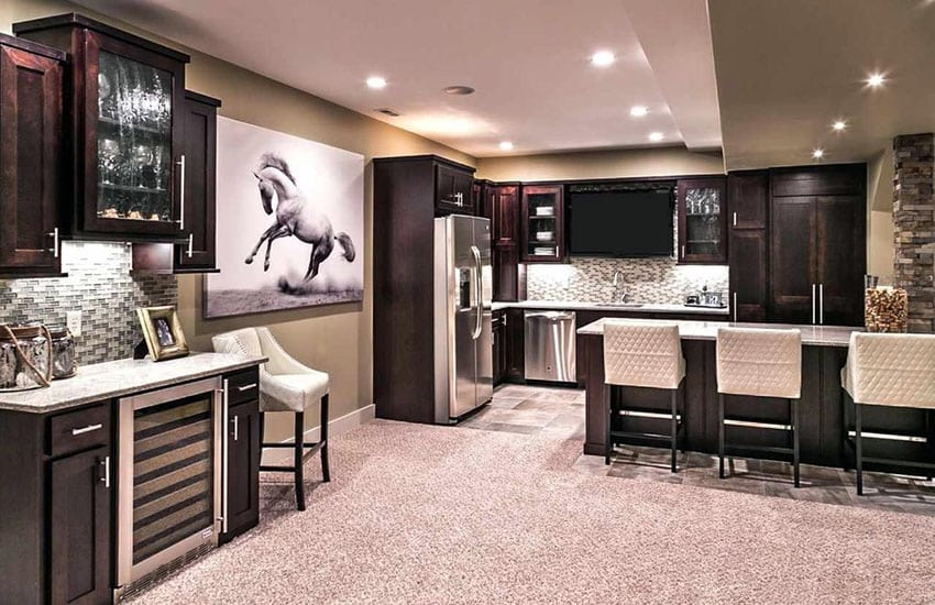 Basement home bar and kitchen with wine fridge and glass backsplash