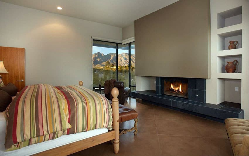 Bedroom with fireplace and mountain view