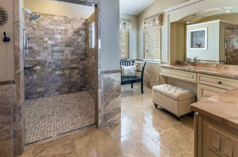 this gallery showcases travertine shower ideas in luxury bathrooms with expansive layouts high end decor and finishes with tones of tan white cream - High End Bathroom Designs
