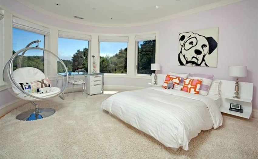 Modern master bedroom with pink painted walls and floor mount swing chair