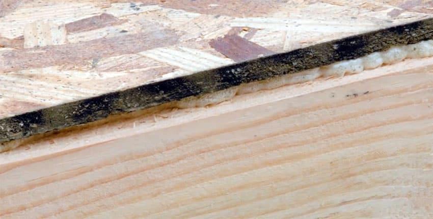 Applying adhesive between subfloor and joist