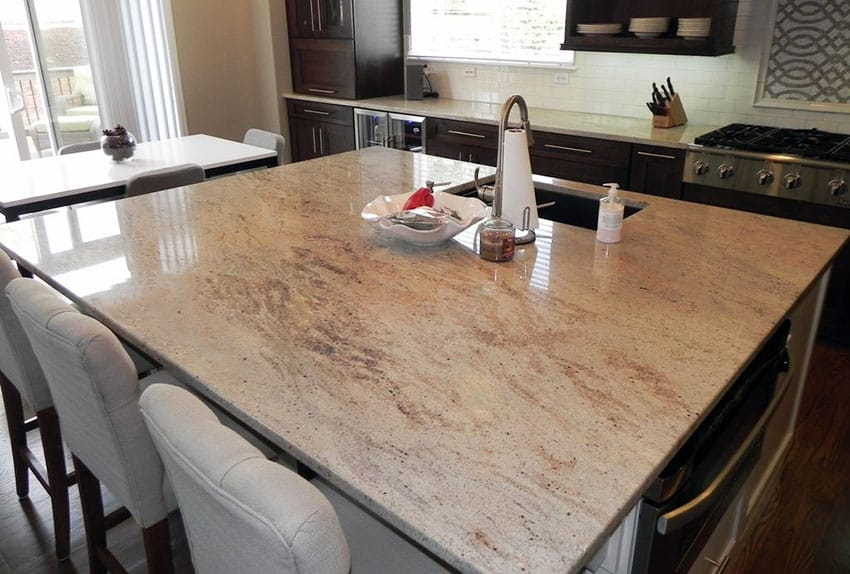 Beautiful kitchen with large island with andromeda white granite slab