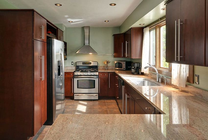 Contemporary kitchen with cherry cabinets and green color paint
