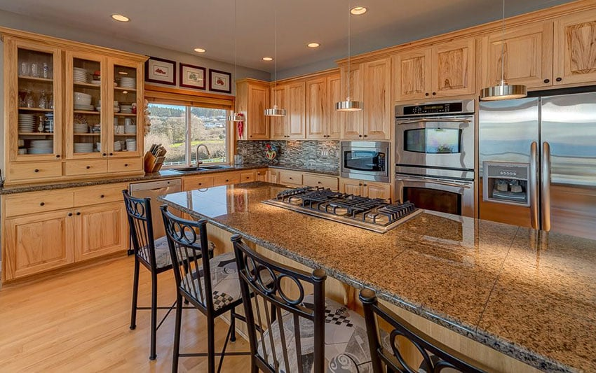 Kitchen island with granite tile countertop