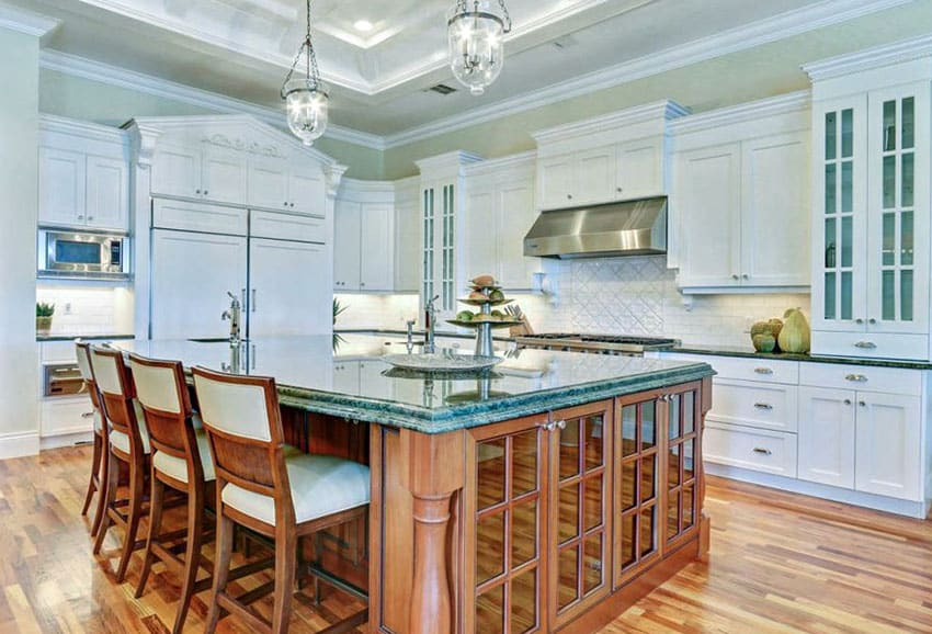 Kitchen with Brazilian green granite counter island and mint green paint color