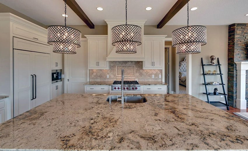 Kitchen with lapidus granite island and white cabinetry