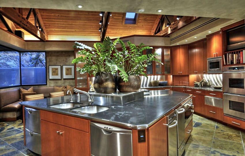Contemporary kitchen with large island packed with stainless steel appliances
