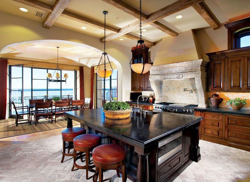 Craftsman kitchen with dark wood cabinetry island and custom stone oven surround