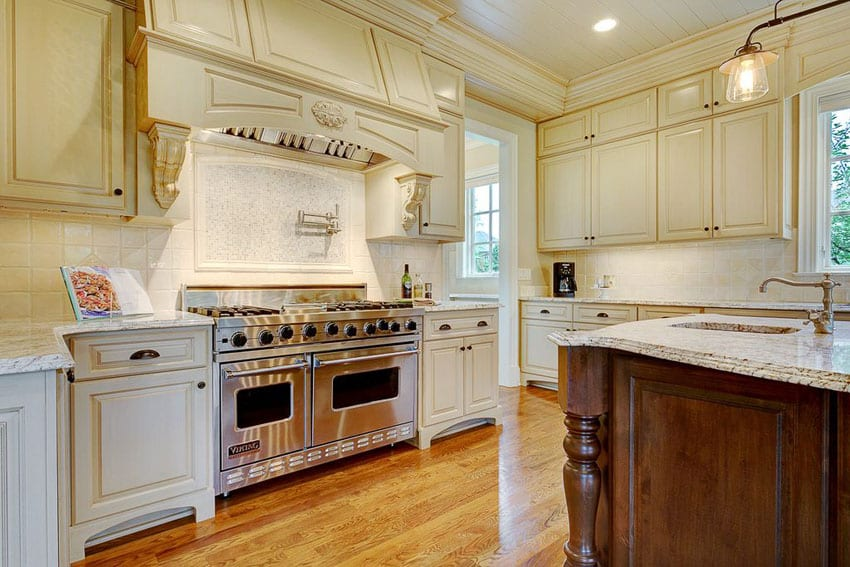 Cream cabinet kitchen with large viking range and island with sink