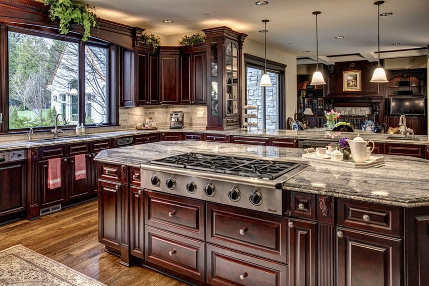 Custom kitchen with stovetop in island and granite countertops