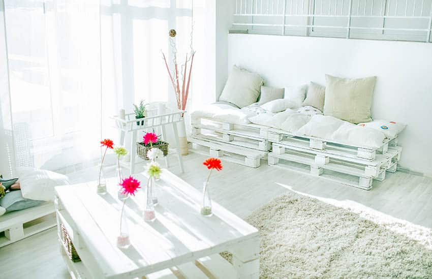 DIY white pallet daybed with cushions and table