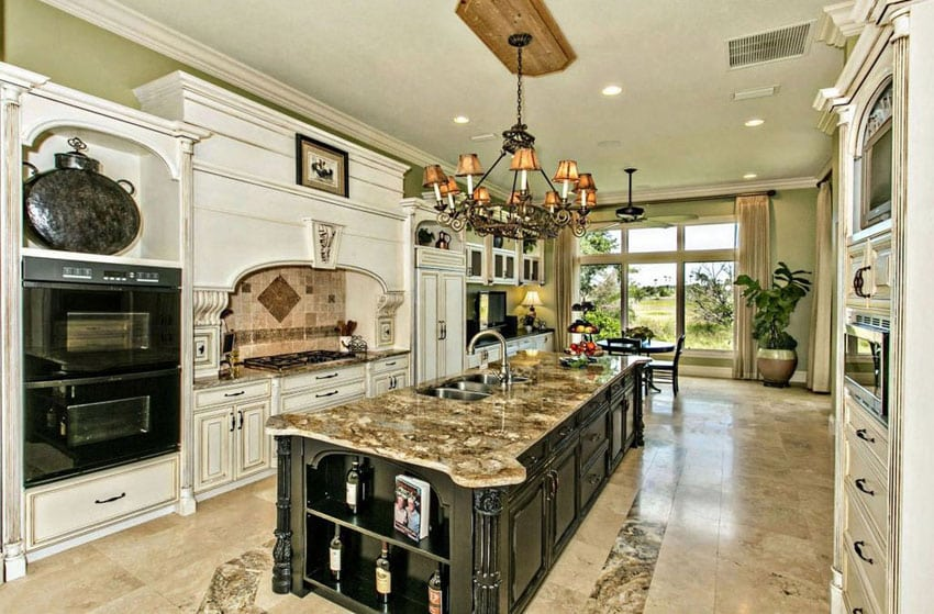 Large traditional kitchen with rectangular island and travertine flooring