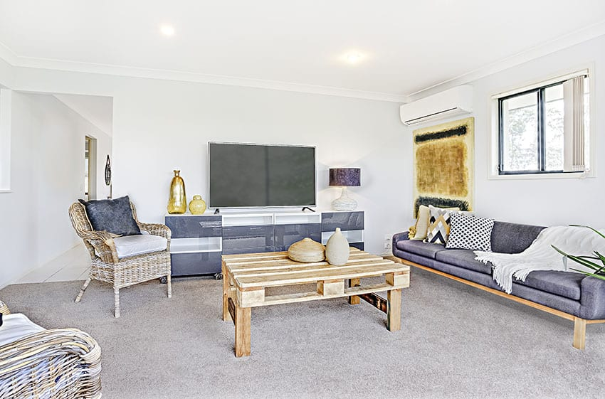 Living room with pallet coffee table with purple couch