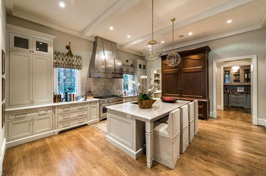 Luxury kitchen with oversized ranged hood and breakfast bar island