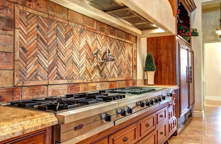 Mediterranean kitchen with viking stovetop and chevron design backsplash