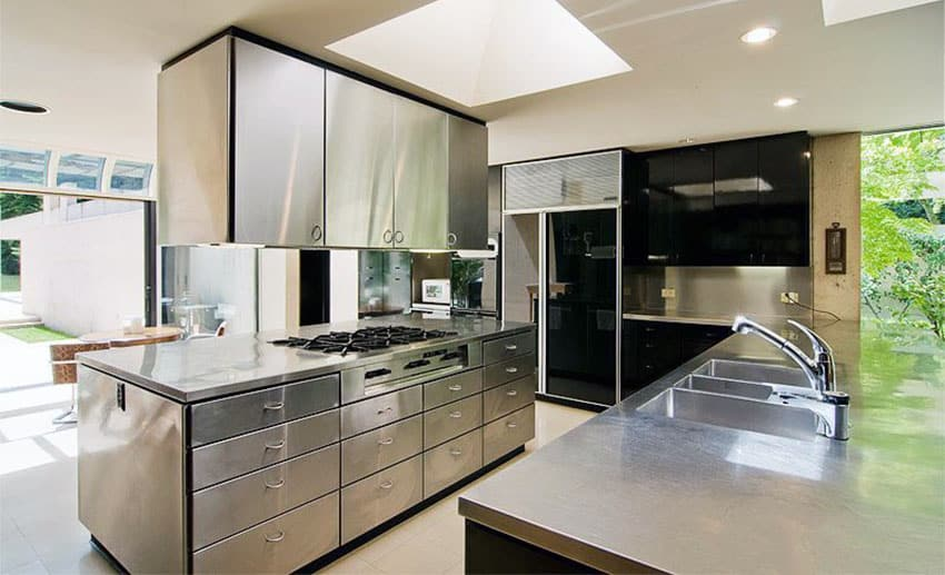 Modern kitchen with stainless steel countertops cabinets and island with cooktop