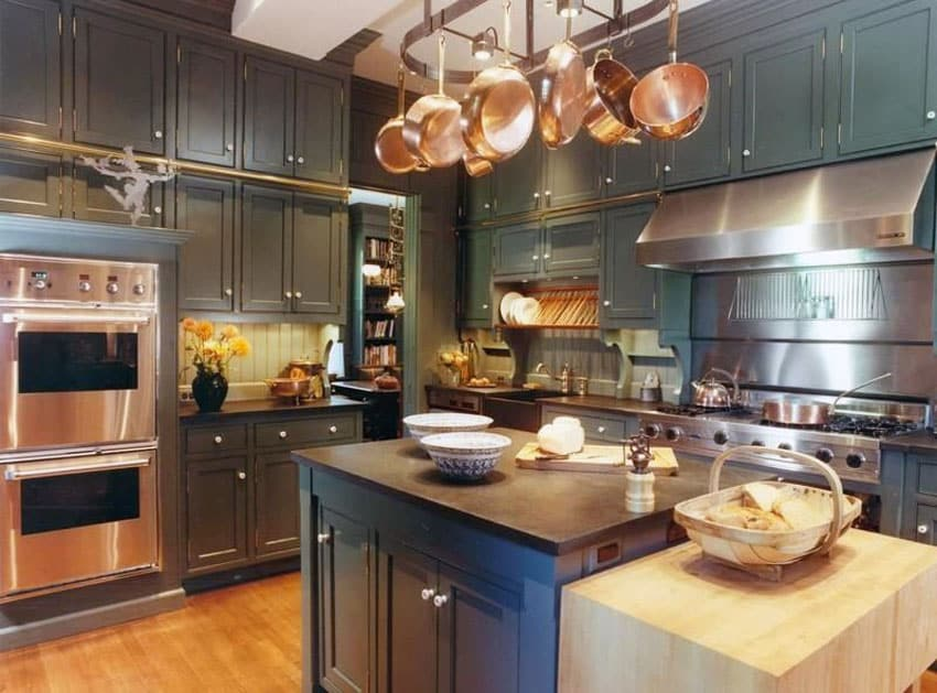 Small country kitchen with high end appliances and butcher block table