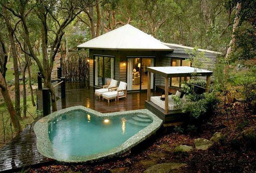 Swimming pool with contemporary cabana and daybed