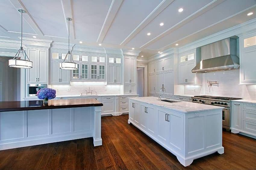 Traditional kitchen with white cabinets hardwood floors and industrial oven