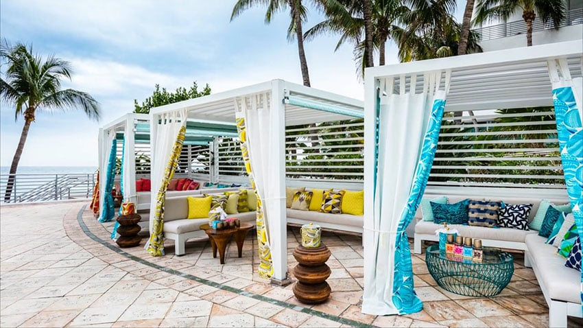 Tropical cabanas with canopy curtains